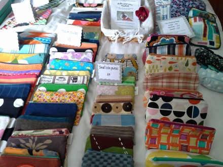 Lots of pouches, purses and iPad covers ready for sale.